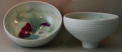 2 footed porcelain bowls, incised sides