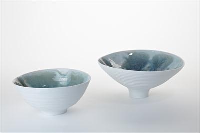 2 porcelain bowls with blue green glazes